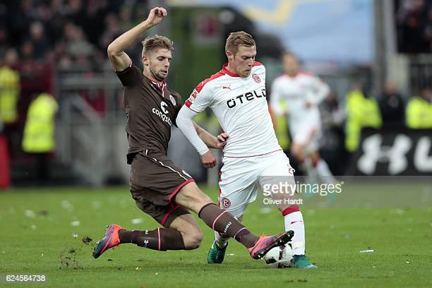 Lasse Sobiech of Pauli and Rouwen Hennings of Duesseldorf compete for the ball during the Second Bundesliga match between FC St Pauli and Fortuna...