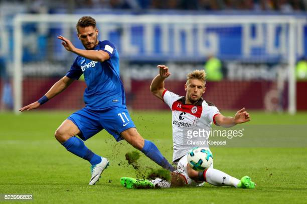 Lasse Sobiech of St Pauli challenges Dimitrios Diamantakos of Bochum during the Second Bundesliga match between VfL Bochum 1848 and FC St Pauli at...