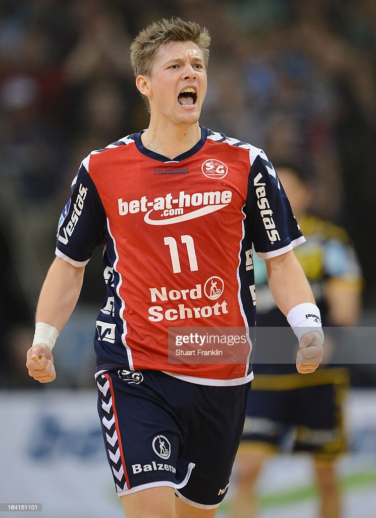 Lasse Svan Hansen of Flensburg celebrates during the Toyota Bundesliga handball game between SG Flensburg-Handewitt and Rhein-Neckar Loewen at the Flens arena on March 20, 2013 in Flensburg, Germany.