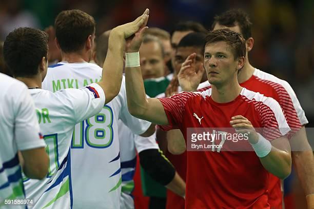 Lasse Svan of Denmark acknowledges the Solvenia team after winning the Men's Quarterfinal Handball contest between Denmark and Slovenia at Future...
