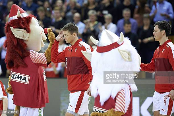 Lasse Svan of Denmark shake hands with mascots prior to the BYGMA Cup 2017 match between Denmark and Island at Ceres Arena on January 08 2017 in...