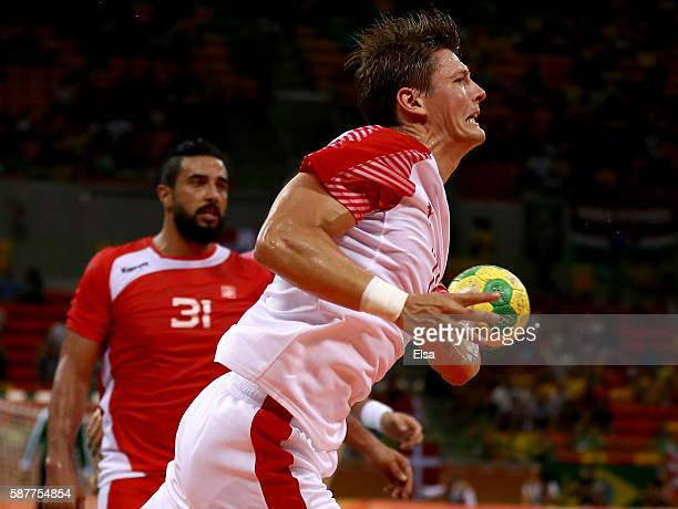 Lasse Svan of Denmark takes a shot as Marouan Chouiref of Tunisia defends on Day 4 of the Rio 2016 Olympic Games at the Future Arena on August 9 2016...
