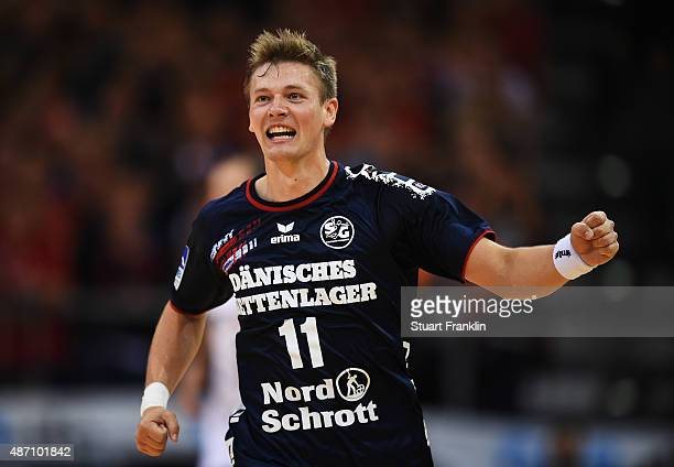 Lasse Svan of Flensburg celebrates scoring during the DKB Handball Bundeslga match between SG FlensburgHandewitt and THW Kiel at FlensArena on...