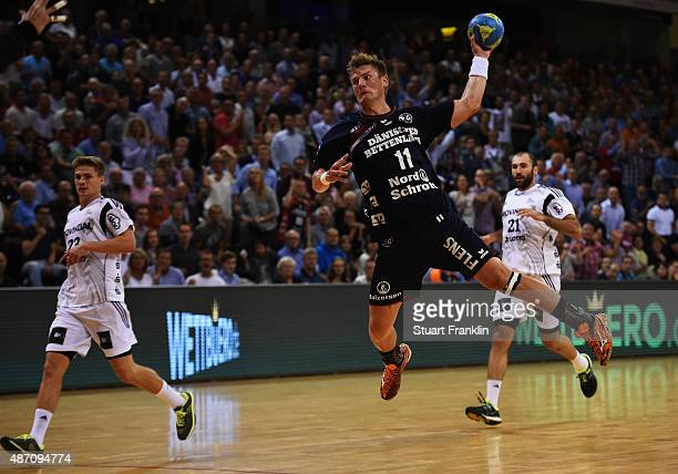 Lasse Svan of Flensburg scores during the DKB Handball Bundeslga match between SG FlensburgHandewitt and THW Kiel at FlensArena on September 6 2015...