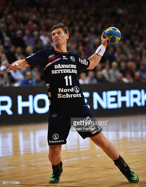Lasse Svan of Flensburg throws a goal during the DKB handball Bundeliga match between SG Flensburg Handewitt and TuS NLuebbecke at FlensArena on...