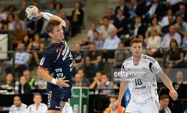 Lasse Svan of FlensburgHandewitt challenges Niclas Ekberg of Kiel during the Pixum Super Cup between THW Kiel and SG Flensburg Handewitt at...