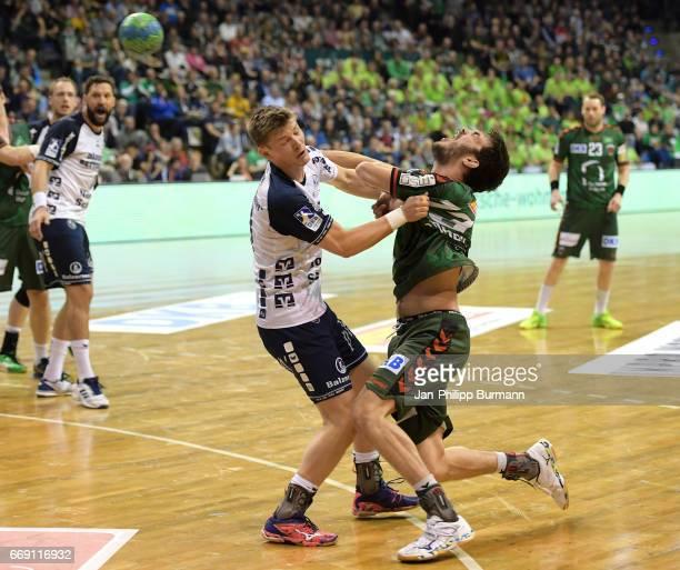 Lasse Svan of SG FlensburgHandewitt and Petar Nenadic of Fuechse Berlin clash during the game between Fuechse Berlin against SG FlensburgHandewitt on...
