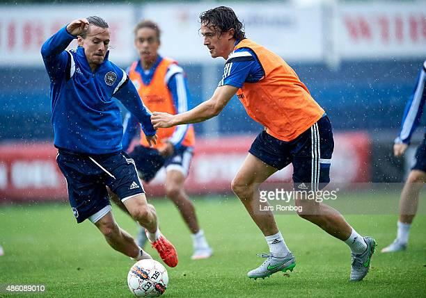 Lasse Vibe and Thomas Delaney compete for the ball during the Denmark training session at Helsingor Stadion on August 31 2015 in Helsingor Denmark
