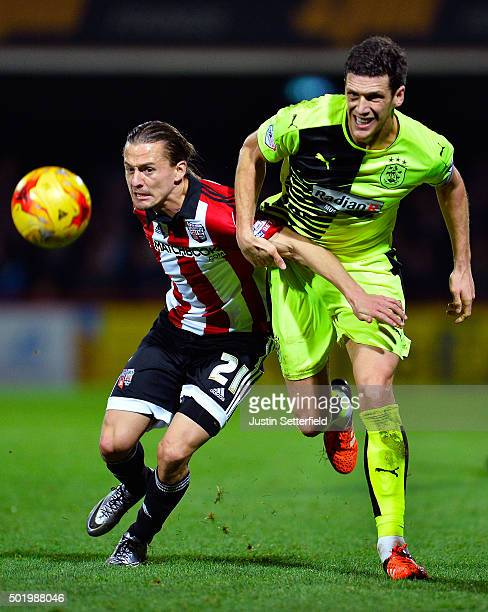 Lasse Vibe of Brentford and Mark Hudson of Huddersfield Town in action during the Sky Bet Championship match between Brentford and Huddersfield Town...