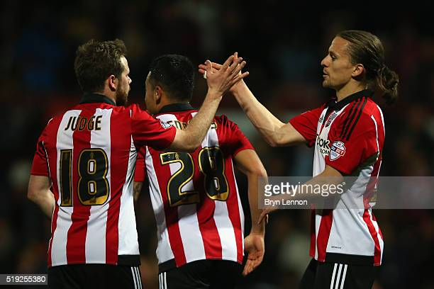 Lasse Vibe of Brentford celebrates with team mates after scoring during the Sky Bet Championship match between Brentford and Bolton Wanderers at...