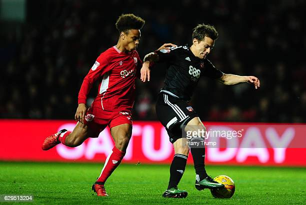 Lasse Vibe of Brentford is tackled by Bobby Reid of Bristol City during the Sky Bet Championship match between Bristol City and Brentford at Ashton...