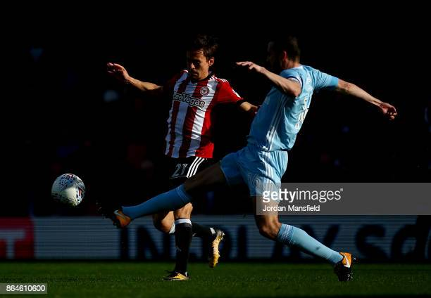 Lasse Vibe of Brentford tackles with John O'Shea of Sunderland during the Sky Bet Championship match between Brentford and Sunderland at Griffin Park...