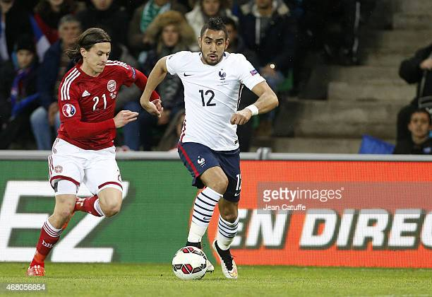 Lasse Vibe of Denmark and Dimitri Payet of France in action during the international friendly match between France and Denmark at Stade...