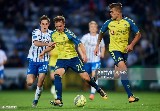 Lasse Vigen Christensen of Brondby IF and Jens Jakob Thomasen of OB Odense compete for the ball during the Danish Alka Superliga match between OB...