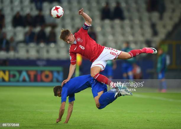 Lasse Vigen Christensen of Denmark and Domenico Berardi of Italy compete for the ball during the UEFA European Under21 Championship Group C match...