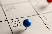 Close up shot of a calendar with a pin on the number 31