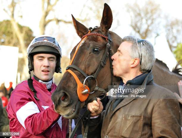 Last Installments jockey Brian O'Connell and owner Michael O'Leary celebrate victory in The Topaz Fort Leney Novice Steeplechase during the Christmas...