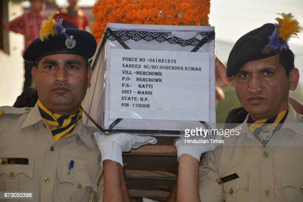 Last journey of martyr CRPF jawan Surender Kumar at native village Ner Chowk before cremation on April 25 2017 in Mandi India