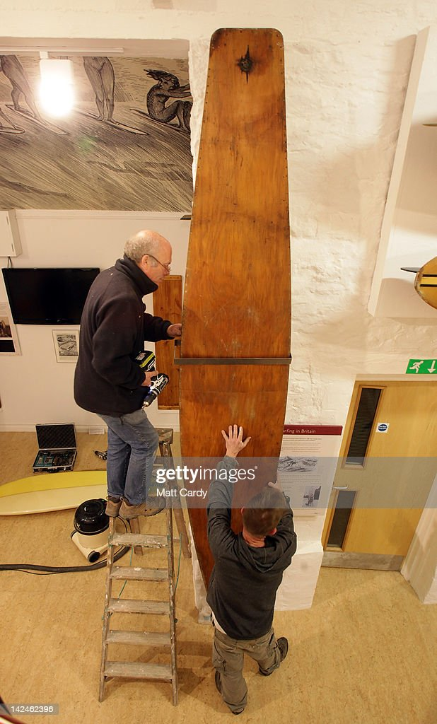 Last minute adjustments are made to historic surfboards displayed inside the new museum on April 5, 2012 in Braunton, England. The museum, which is the first in Europe dedicated to surfing, opens to the public tomorrow. The Devon-based charity, which originally started online, holds the largest surfboard collection in Britain. As well as the collection of surfboards dating back over 100 years, the museum also holds early wetsuits, photos and other memorabilia relating to the phenomenal growth in the popularity of surfing. Surfing is now a multi-million pound industry and employs 1000s of people in the UK.