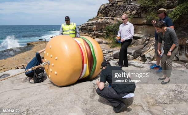 Last minute checks by staff next to 'What a Tasty Looking Burger' by James Dive at Sculpture By The Sea on October 18 2017 in Sydney Australia The...
