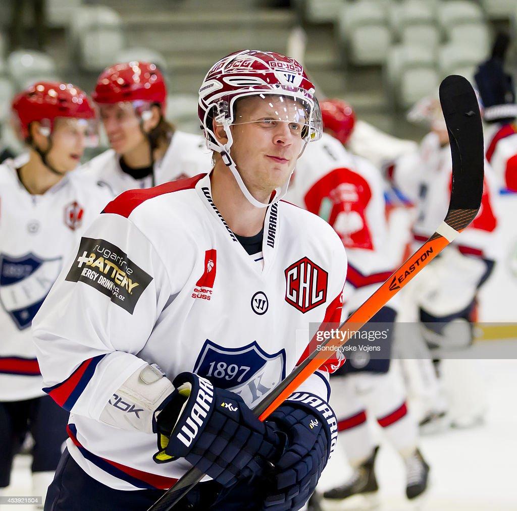Last season's top scorer Juuso Puustinen #71 of IFK Helsinki looks on after victory in the Champions Hockey League group stage game between Sonderjyske Vojens and IFK Helsinki on August 21, 2014 in Vojens, Denmark.