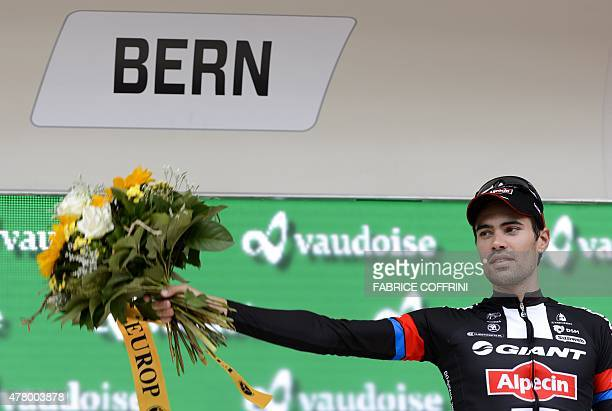 Last stage winner and overall thirdplaced Netherland's Tom Dumoulin of Giant team poses on the podium during the podium ceremony after the final...