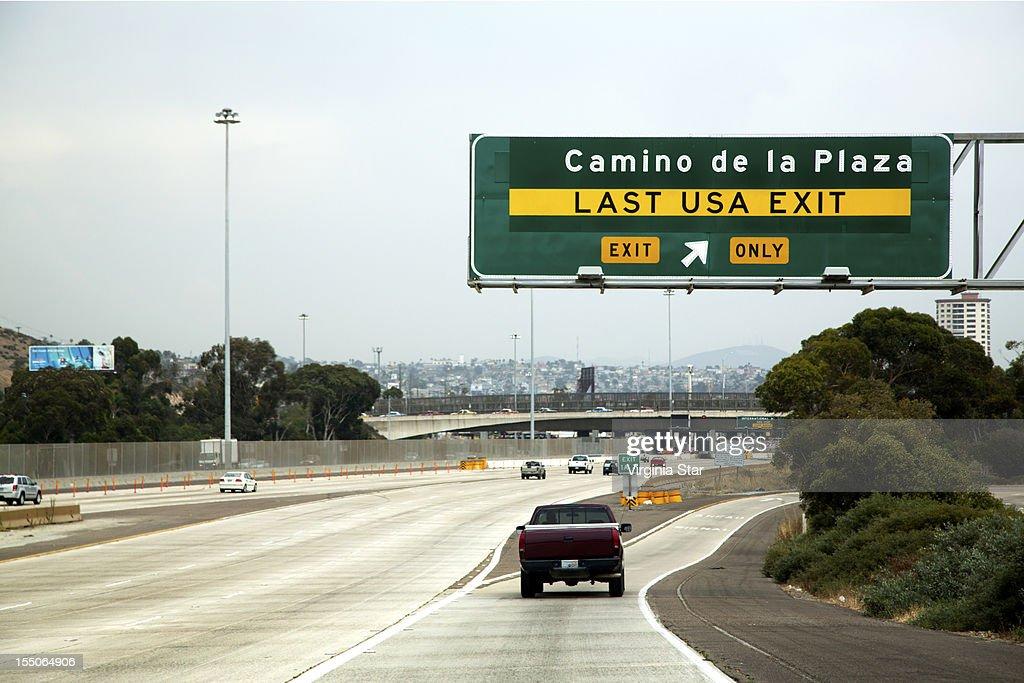Last USA freeway exit before Tijuana Mexico : Stock Photo