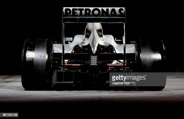 A last year's Brawn GP car in the new colours of Mercedes GP Petronas team is seen during the Mercedes GP Petronas Formula One Team presentation at...