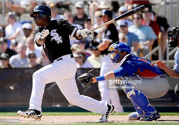 Lastings Milledge of the Chicago White Sox plays against Chicago Cubs during the spring training baseball game at Camelback Ranch on March 11 2011 in...