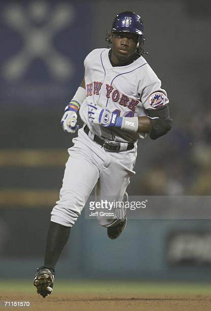 Lastings Milledge of the New York Mets rounds the bases after hitting a tworun home run in the seventh inning against the Los Angeles Dodgers during...