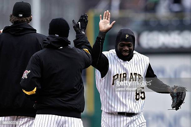 Lastings Milledge of the Pittsburgh Pirates celebrates with teammates following their 53 win against the Cincinnati Reds on April 18 2010 at PNC Park...