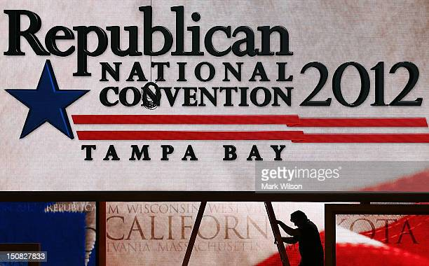 Lastminute adjustments are made to the main stage at the Tampa Bay Times Forum on the abbreviated first day of the Republican National Convention...