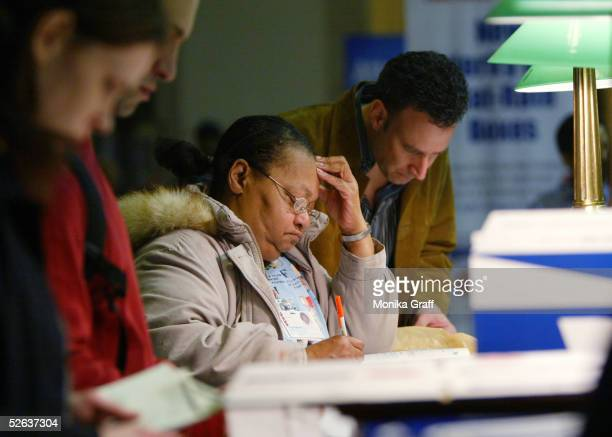 Lastminute filers fill out their tax forms at the James A Farley post office before the midnight deadline April 15 2005 in New York City The Internal...