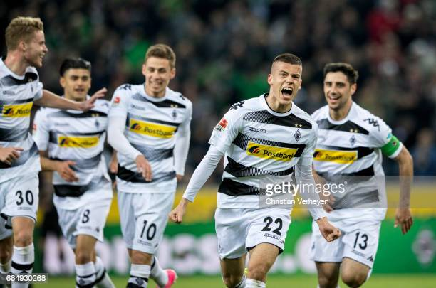 Laszlo Benes of Borussia Moenchengladbach celebrate with his teammates after he scores his teams first goal during the Bundesliga Match between...
