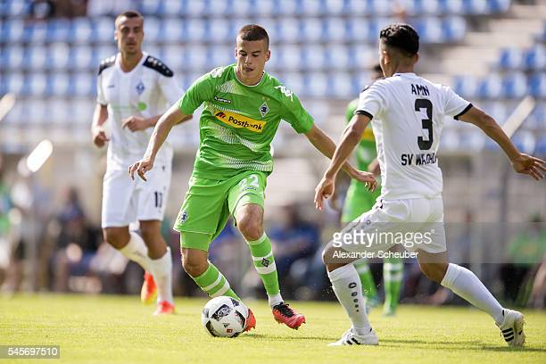 Laszlo Benes of Borussia Moenchengladbach challenges Hassan Amin of SV Waldhof Mannheim during the friendly match between SV Waldhof Mannheim and...