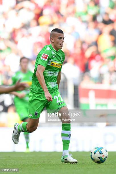 Laszlo Benes of Borussia Moenchengladbach plays the ball during the Bundesliga match between FC Augsburg and Borussia Moenchengladbach at WWKArena on...