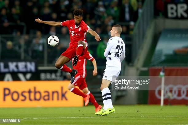 Laszlo Benes of Moenchengladbach challenges Coman of Bayern during the Bundesliga match between Borussia Moenchengladbach and Bayern Muenchen at...