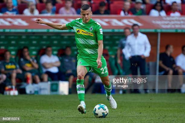 Laszlo Benes of Moenchengladbach controls the ball during a Bundesliga match between FC Augsburg and Borussia Moenchengladbach at WWK Arena on August...