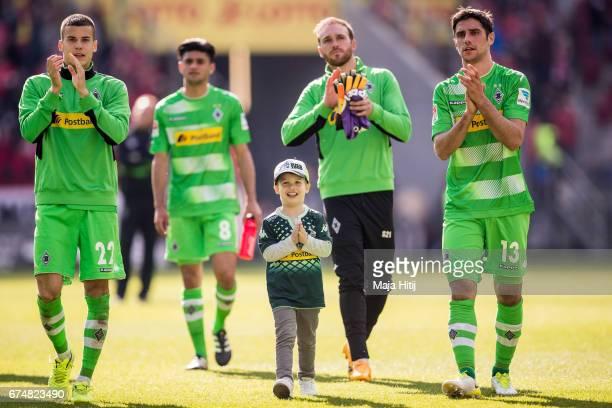 Laszlo Benes of Moenchengladbach Mahmoud Dahoud Tobias Sippel and Lars Stindl celebrate after the Bundesliga match between 1 FSV Mainz 05 and...
