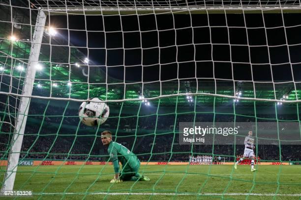 Laszlo Benes of Moenchengladbach scores a goal to make it 54 during penalty shoot out against Lukas Hradecky goal keeper of Frankfurt during the DFB...