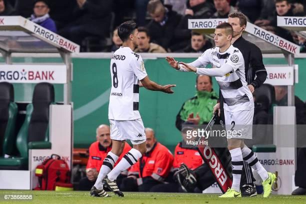 Laszlo Benes of Moenchengladbach substitues Mahmoud Dahoud of Moenchengladbach during the DFB Cup semi final match between Borussia Moenchengladbach...