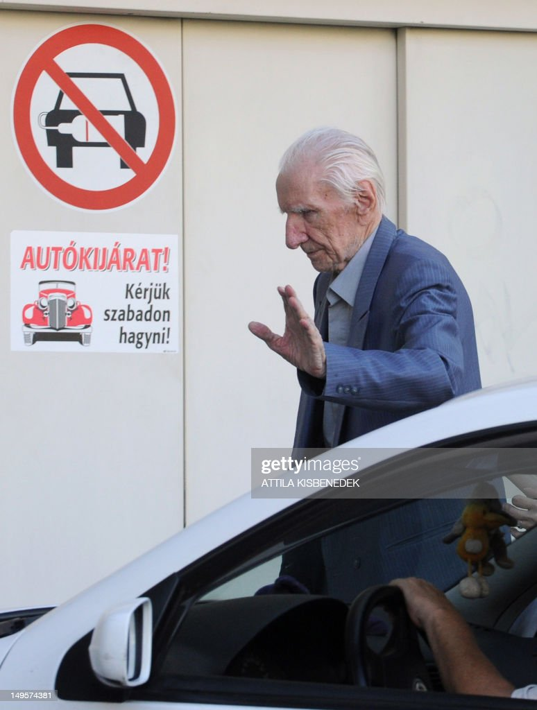 Laszlo Csatary, aka Ladislaus Csizsik-Csatary, arrives back to his home, where he is under house arrest, in Budapest on July 31, 2012, after his interrogation by the prosecutor office. Accused by the Wiesenthal Center of organising the World War II deportation to their deaths of some 16,000 Jews from the ghetto of Kosice in present-day southeast Slovakia -- the ethnic Hungarian has protested his innocence. In 1948, a court in then-Czechoslovakia sentenced him to death in absentia, but he made it to Canada where he lived and worked as an art dealer before being stripped of his citizenship in the 1990s.