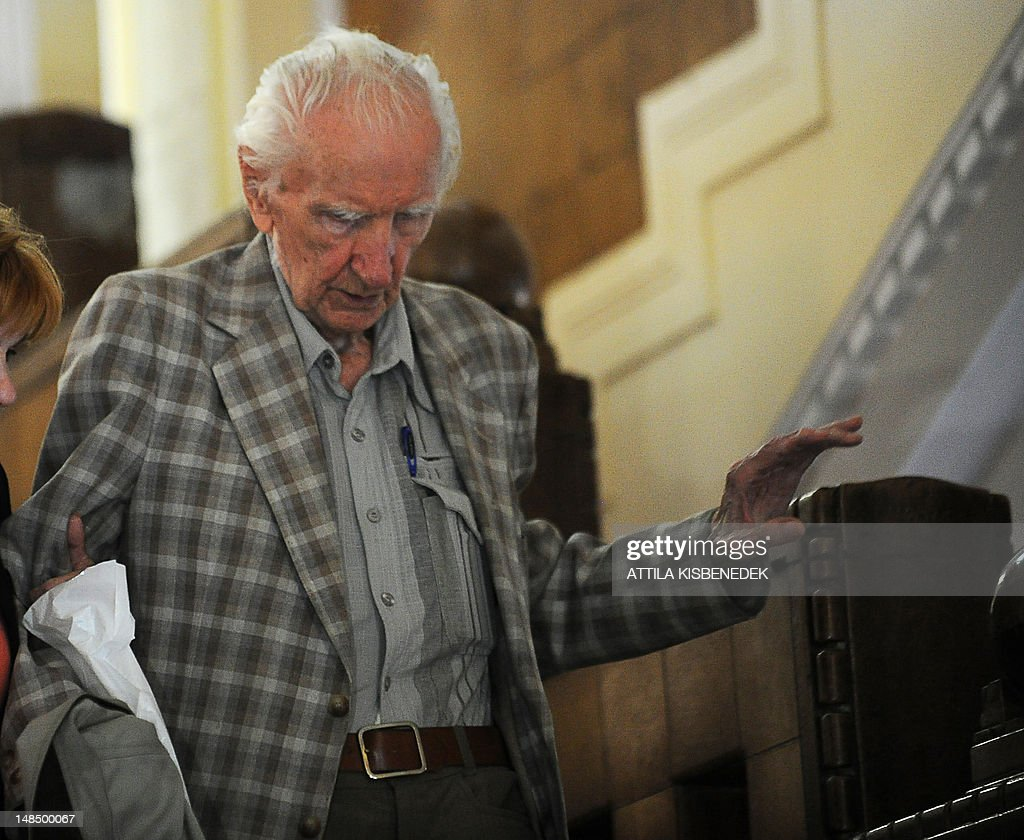 Laszlo Csatary, aka Ladislaus Csizsik-Csatary, leaves the courthouse in Budapest on July 18, 2012, after he was placed under house arrest for 30 days following questioning by an investigative judge at the military's prosecution's office. Meanwhile the Simon Wiesenthal Centre welcomed the arrest by Hungarian police of the Nazi war crimes suspect, who topped the US Nazi-hunting organisation's most wanted list. Csatary is accused by the Wiesenthal Center of having helped organise the deportation of some 15,700 Jews to the Auschwitz death camp during World War II.
