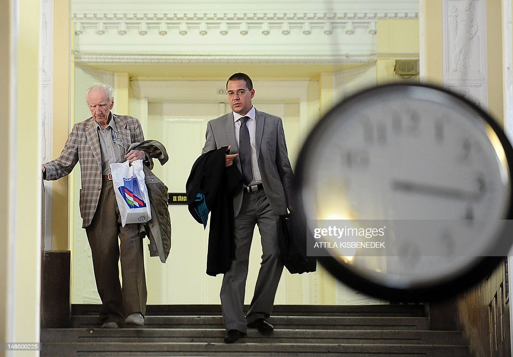 Laszlo Csatary (L), aka Ladislaus Csizsik-Csatary, leaves the courthouse in Budapest on July 18, 2012, with his Hungarian appointed lawyer Gabor Horvath (R), after he was placed under house arrest for 30 days following questioning by an investigative judge at the military's prosecution's office. Meanwhile the Simon Wiesenthal Centre welcomed the arrest by Hungarian police of the Nazi war crimes suspect, who topped the US Nazi-hunting organisation's most wanted list. Csatary is accused by the Wiesenthal Center of having helped organise the deportation of some 15,700 Jews to the Auschwitz death camp during World War II.