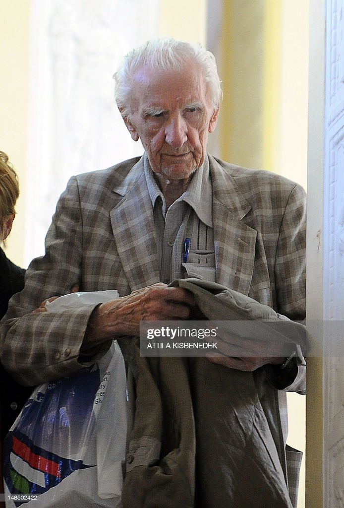 Laszlo Csatary (L), aka Ladislaus Csizsik-Csatary, leaves the courthouse in Budapest on July 18, 2012, after he was placed under house arrest for 30 days following questioning by an investigative judge at the military's prosecution's office. Meanwhile the Simon Wiesenthal Centre welcomed the arrest by Hungarian police of the Nazi war crimes suspect, who topped the US Nazi-hunting organisation's most wanted list. Csatary is accused by the Wiesenthal Center of having helped organise the deportation of some 15,700 Jews to the Auschwitz death camp during World War II.