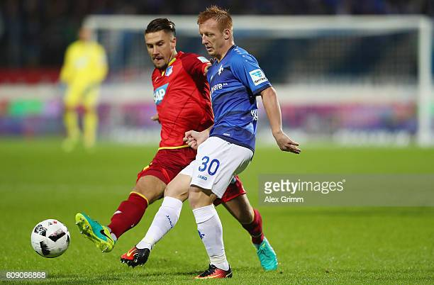 Laszlo Kleinheisler of Darmstadt is challenged by Ermin Bicakcic of Hoffenheim during the Bundesliga match between SV Darmstadt 98 and TSG 1899...