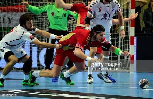 Laszlo Nagy of Hungarian MKB Veszprem fights for the ball with Zlatko Horvat of PPD Zagreb on February 21 2016 in Veszprem during their EHF Champions...