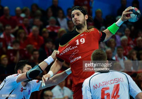 Laszlo Nagy of Hungarian MKB Veszprem is pushed by Tin Kontrec of PPD Zagreb on February 21 2016 in Veszprem during their EHF Champions League match...
