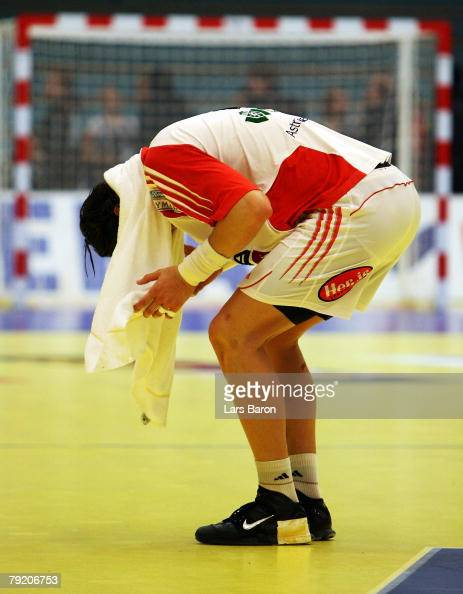 Laszlo Nagy of Hungary stands dejected on the floor after loosing the Men's Handball European Championship main round Group II match between Hungary...