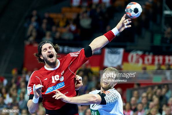 Laszlo Nagy of Hungary throws the ball against Steffen Weinhold of Germany during the Men's EHF Handball European Championship 2016 match between...